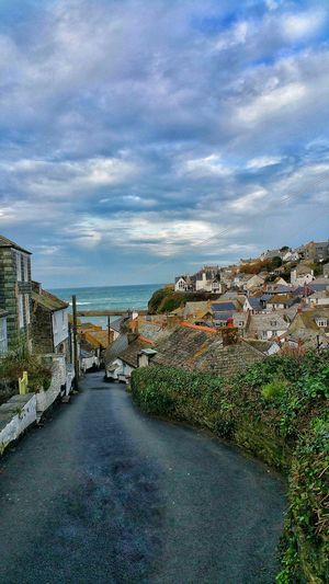 Sky Cloud - Sky Architecture Outdoors No People Day Water Nature Cityscape City Village From My Point Of View Beautiful Nature Outdoor Photography Stone Cottages FishingVillage Coastline Cornwall Portwenn Doc Martin United Kingdom Architecture Cloudy Day Blue Sky Rooftops