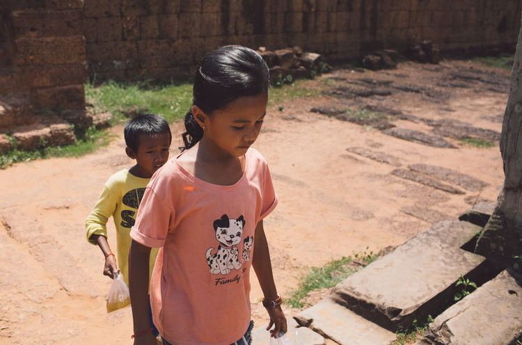 Siem Reap Cambodia Angkor Childhood Child Males  Sunlight Boys Day Two People Lifestyles Females Leisure Activity Men Girls People Real People Togetherness Focus On Foreground Nature Casual Clothing Women Outdoors Innocence