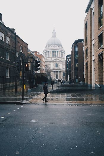 Man walking on street in city