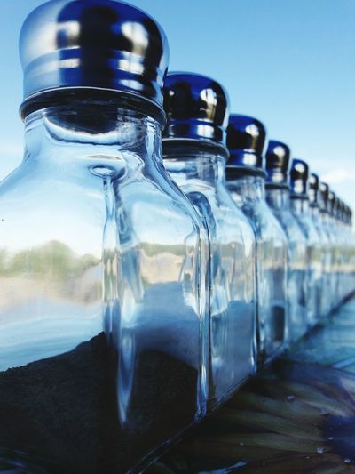 Close-up of glass bottles arranged on table