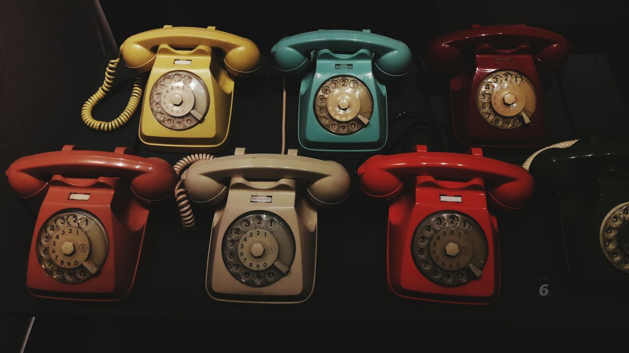 old-fashioned, retro styled, alarm clock, telephone, antique, time, indoors, clock, red, multi colored, no people, telephone receiver, technology, close-up, clock face, day