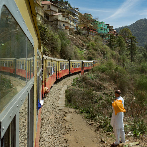Kalka–Shimla railway Transportation One Person Architecture Rail Transportation Built Structure Full Length Nature Plant Tree Public Transportation Day Train Train - Vehicle Mode Of Transportation Building Exterior Standing Travel Real People Outdoors Track