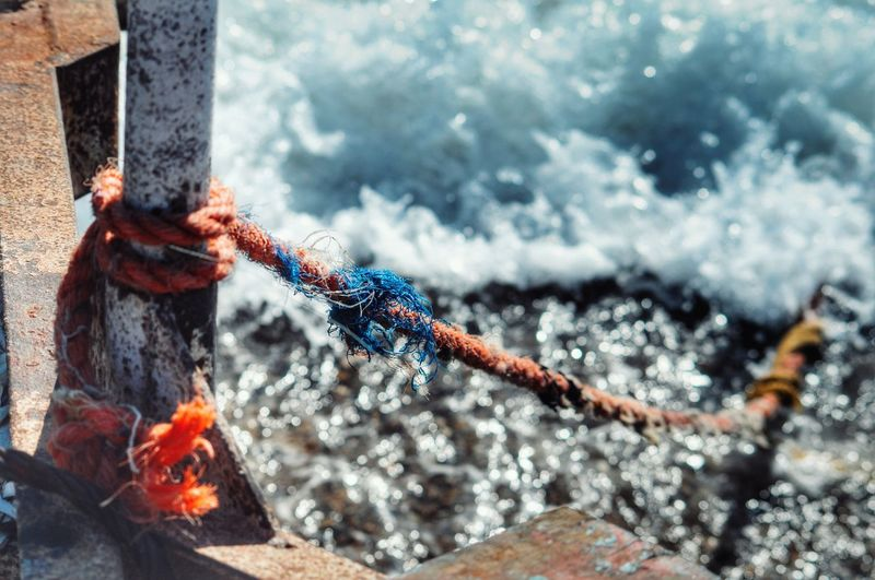 High Angle View Of Rope Tied On Metal