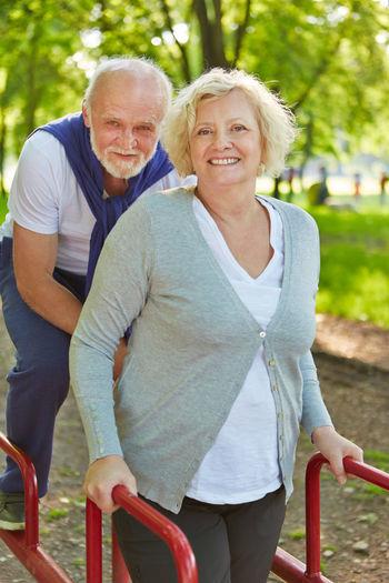 Portrait Of Senior Woman Standing At Park