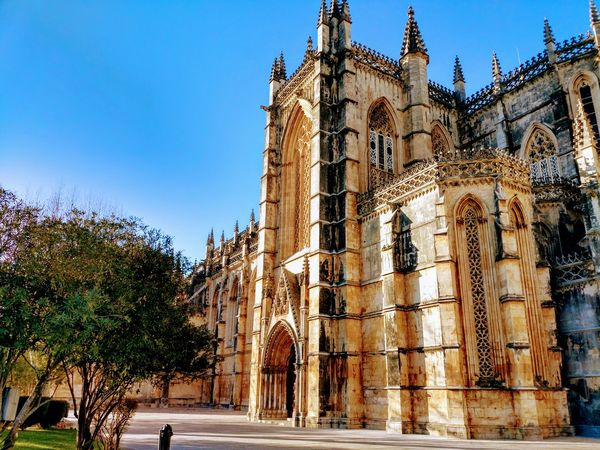Portugal Mosteiro Da Batalha Religion Travel Destinations Place Of Worship History Day Clear Sky No People Built Structure Architecture Spirituality