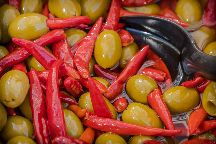 Chilli's and olives being sold on a market Chillis & Olives Food And Drink Olive Abundance Backgrounds Chilli Chillies Chillies Red Close-up Day Food Food And Drink Foodphotography Freshness Full Frame Healthy Eating Indoors  Large Group Of Objects No People Olives Red Vegetable