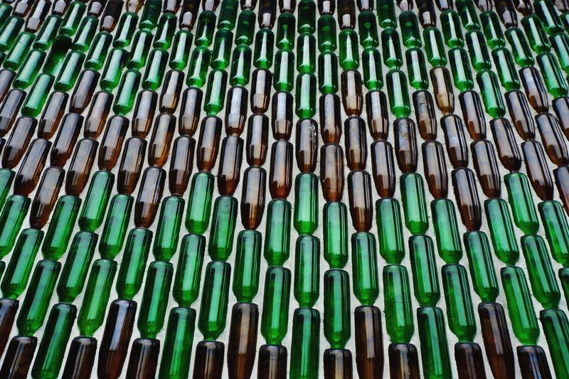 Bottle Wall Bottle Pagoda Pagoda Sisaket,thailand Sisaket Thai Temple Architecture Thai Temple Bottle Wall Bottle Art Green Color Abundance Large Group Of Objects Full Frame No People Backgrounds Day Pattern Close-up Arrangement Bamboo Outdoors Wood - Material Side By Side Nature Low Angle View Still Life Repetition In A Row Brown