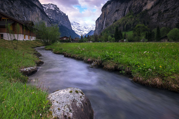 View of river flowing through mountains