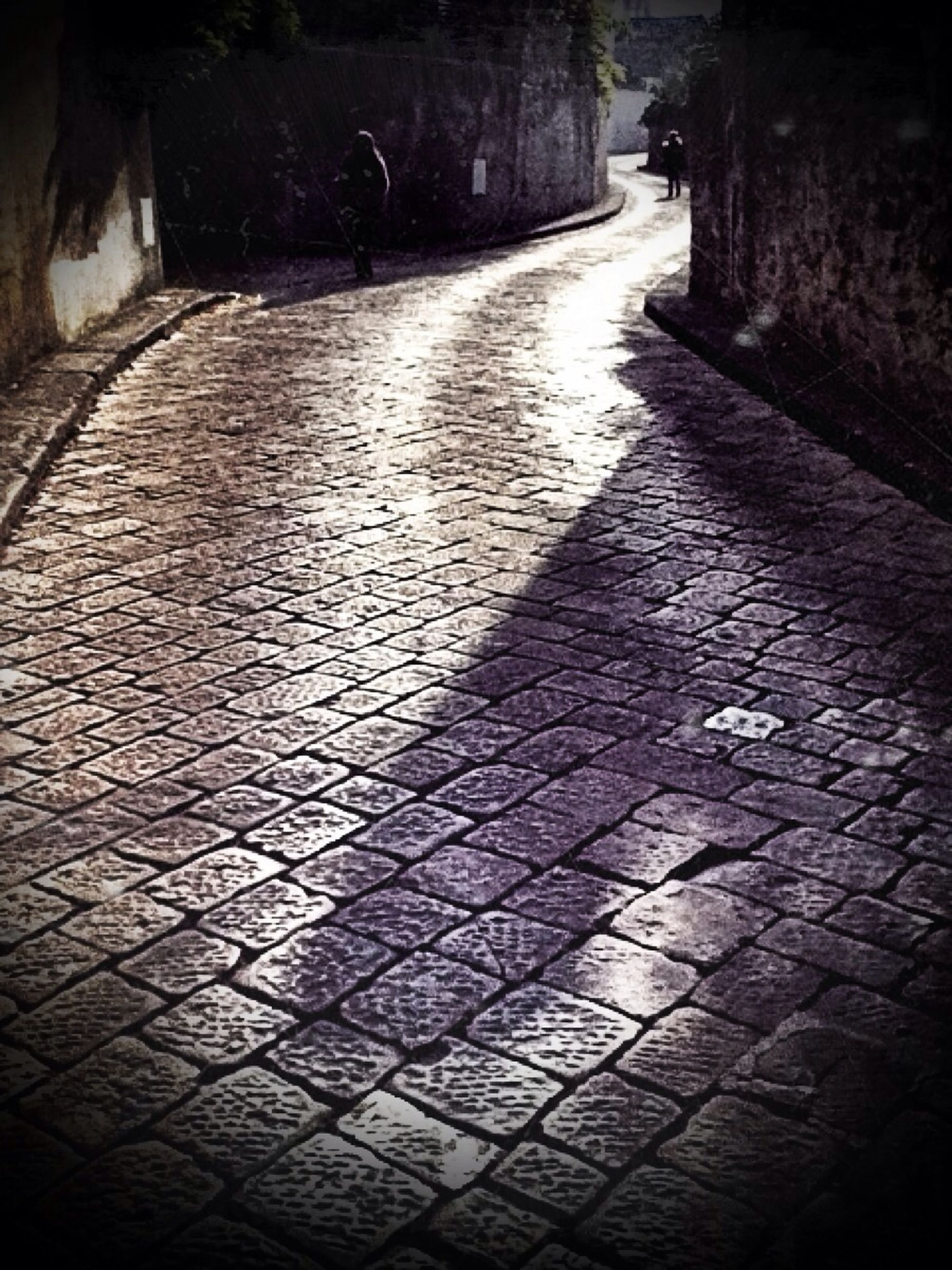 the way forward, diminishing perspective, cobblestone, built structure, architecture, shadow, vanishing point, sunlight, walkway, footpath, narrow, paving stone, empty, street, pattern, pathway, wall - building feature, night, no people, absence