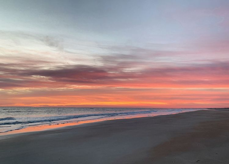 St. Augustine Beach at daybreak St. Augustine Beach Daybreak Sunrise Beach Sunset Sky Cloud - Sky Sea Scenics - Nature Land Beauty In Nature Beach Water Tranquility Orange Color Tranquil Scene Sand Nature No People Horizon Idyllic Horizon Over Water Dramatic Sky Romantic Sky