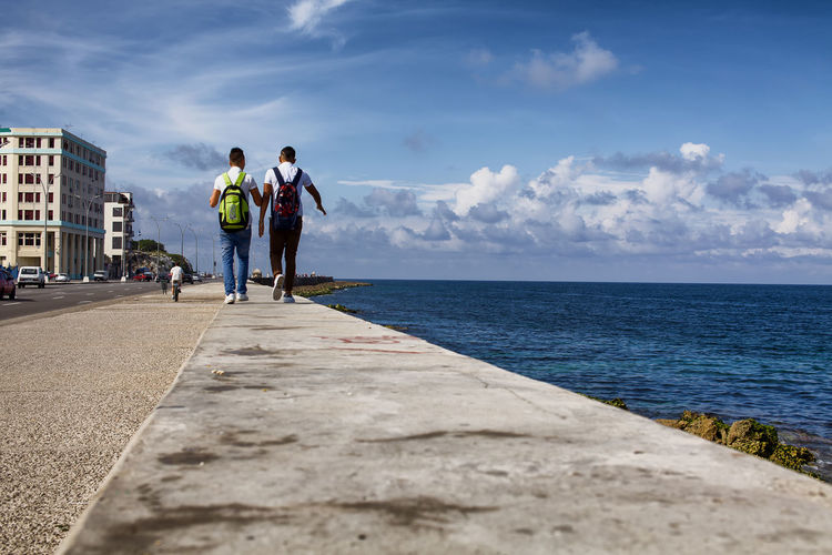 Friends Students Cuban Friendship Horizon Horizon Over Water Leisure Activity Lifestyles Malecón, La Habana School Mates Sea Togetherness Two People Walking Water