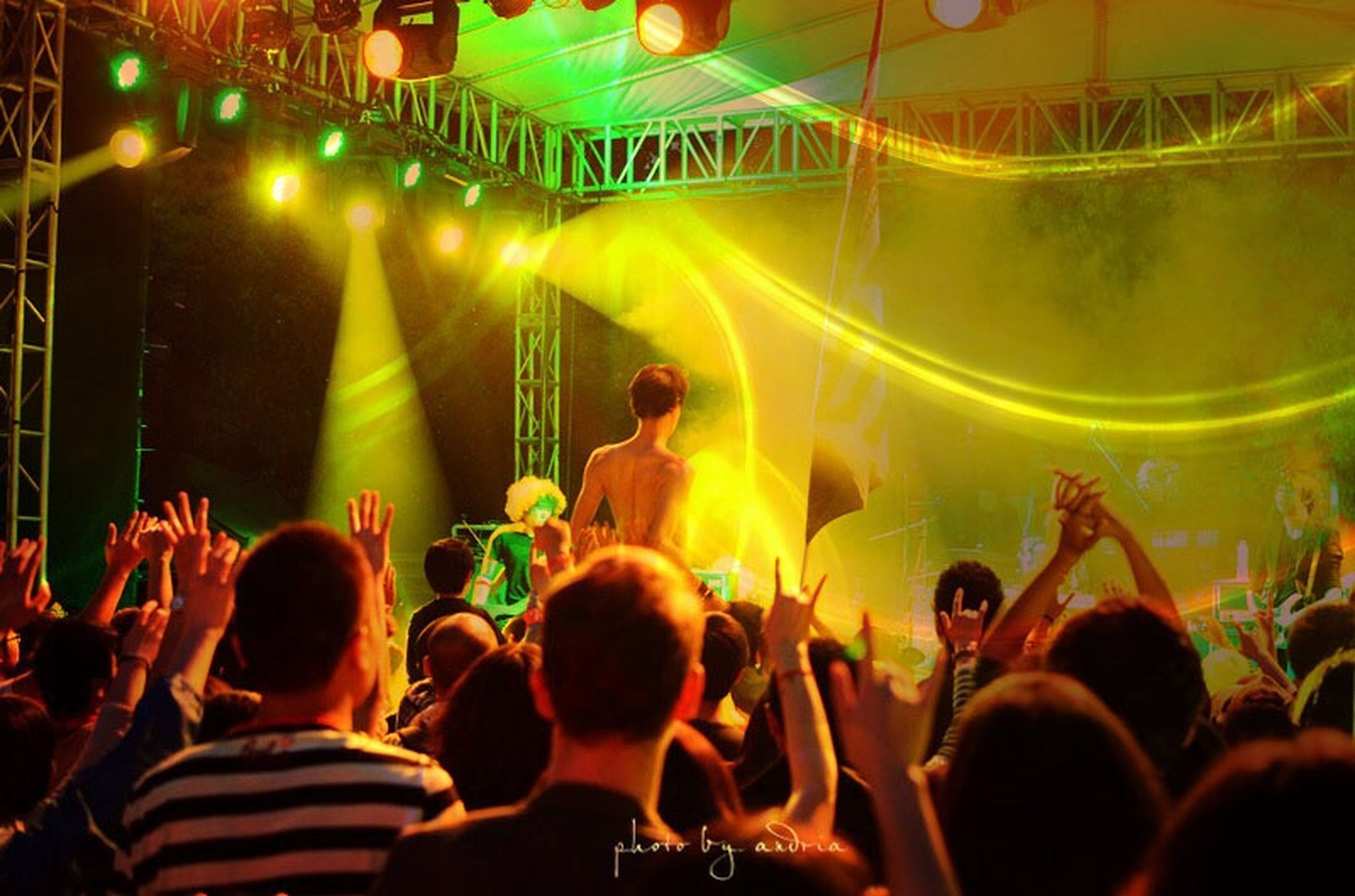 large group of people, crowd, arts culture and entertainment, person, illuminated, men, indoors, lifestyles, event, music, enjoyment, performance, leisure activity, nightlife, fun, stage - performance space, popular music concert, concert