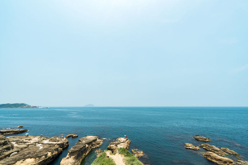 Sea Water Sky Scenics - Nature Beauty In Nature Horizon Over Water Horizon Tranquility Tranquil Scene Copy Space Day Nature No People Blue Beach Land Clear Sky Outdoors Idyllic Rocky Coastline