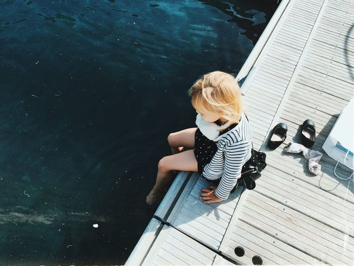 High angle view of boy sitting on boat