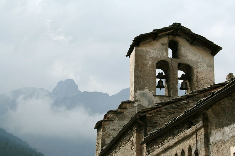 Mountain No People Outdoors Travel Destinations Sky Day Bell Old Architecture Old Church Bell Tower Foggy Mountains Mountain Village Nature Harmony Atmospheric Mood Stone Building Silence Moment Italian Village  Italian Alps Village Chianale EyeEmNewHere
