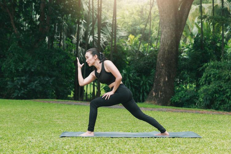 Woman exercising yoga at park