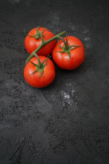 Fresh tomatoes Nobody Black Copy Space Dark Food Photography Foodphotography Food And Drink Food Healthy Eating Wellbeing Vegetable Tomato Freshness Red Raw Food No People High Angle View Still Life Ripe Healthy Lifestyle Juicy Orange Color Close-up Organic