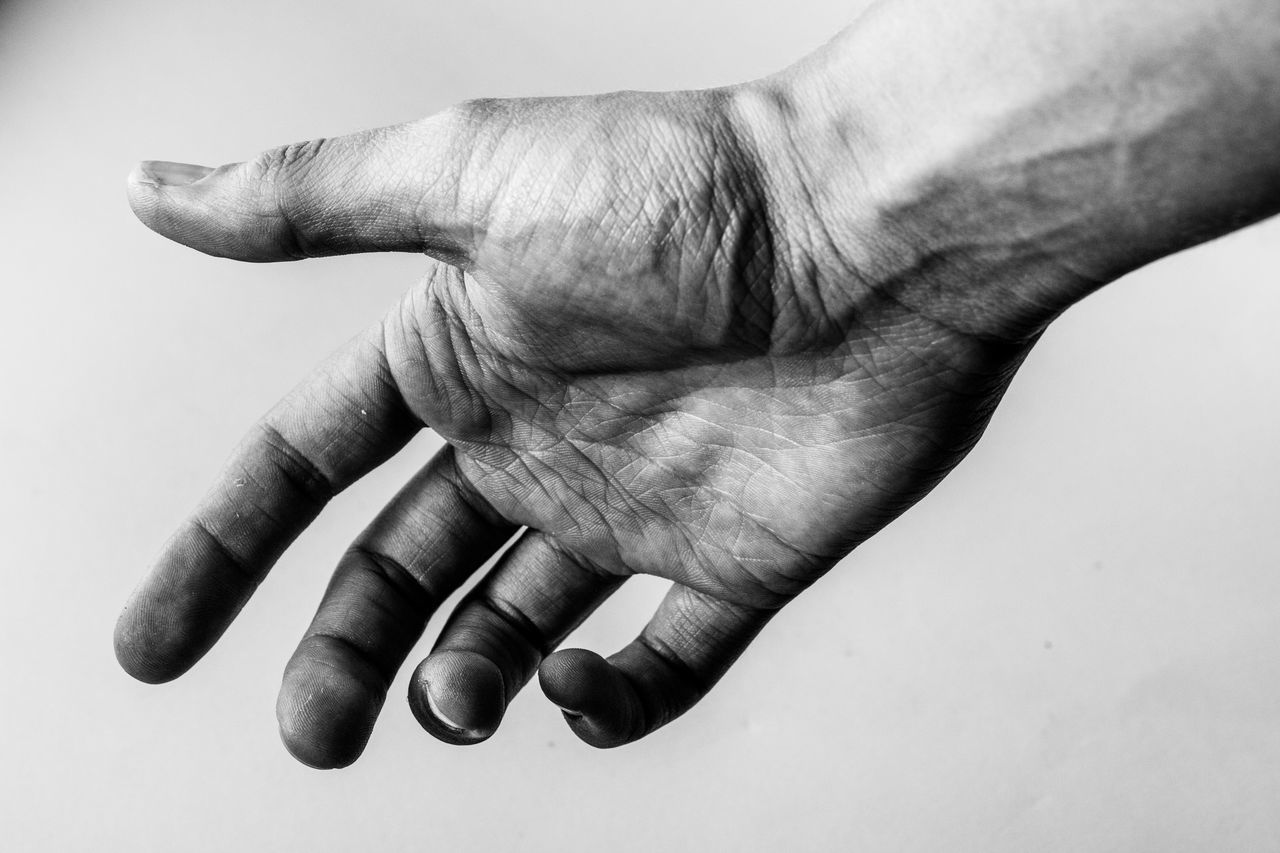 Cropped dirty hand against white background