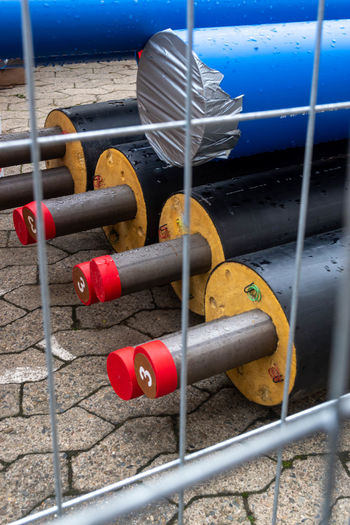 Close-up of metal railing at beach
