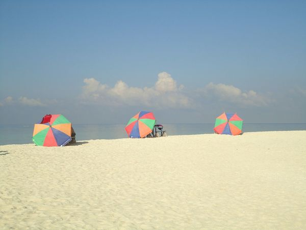 And if you have a minute why don't we go, somewhere only we know. No People Travel Destinations Beachphotography Beach Umbrellas White Sand Beach Camiguin White Island Philippines Three Umbrellas Day Multi Colored Eye Best Shots Travel Lights And Colors EyeEm Best Shots