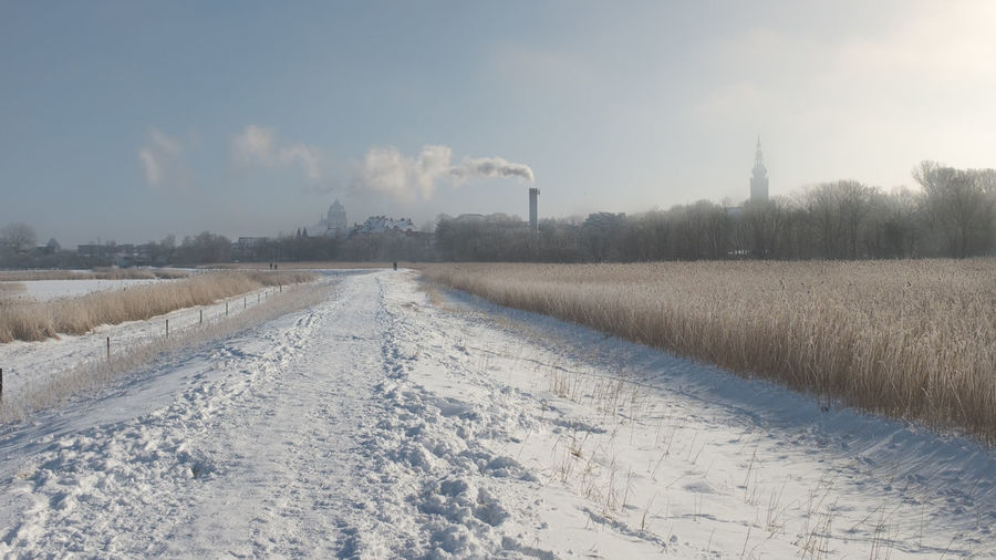 Scenic view of field against sky during winter