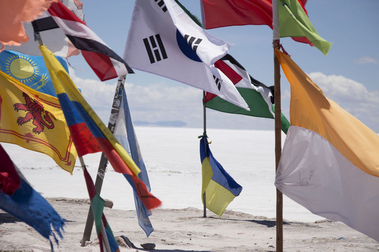 View Of Country Flags On Beach