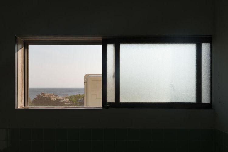 EyeEm Selects Window Indoors  Looking Through Window Cityscape No People Day Architecture Seaside Log Pile Rishiri Island Hokkaido Japan