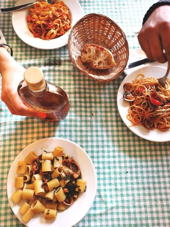 Food Human Hand Food And Drink Freshness High Angle View Plate Serving Size Human Body Part One Person Indoors  Healthy Eating Ready-to-eat People Day Adults Only Adult Seafood Madness Friendship Group Friends Lunch Meal Restaurant Pasta Pasta Time