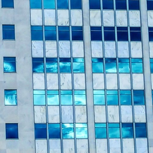 Buildings reflecting clouds Architecture Building Exterior Built Structure Modern Blue Window Pattern No People Outdoors Sky Close-up Tadaa Community Architecture Building And Sky Building Structures Fine Art Photography Adapted To The City