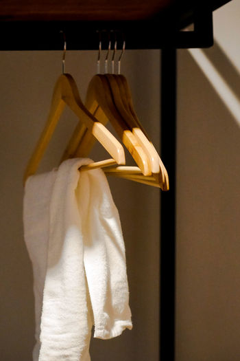Close-up of clothes hanging on coathanger at store
