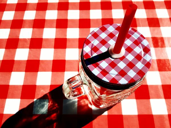 Red & White Checked Pattern Tablecloth Red Pattern No People Day Pattern Pieces Patterns Outdoors Glass Jar Glass Jars On The Table Terrace Glass Mug Picnic Weekend Freshness