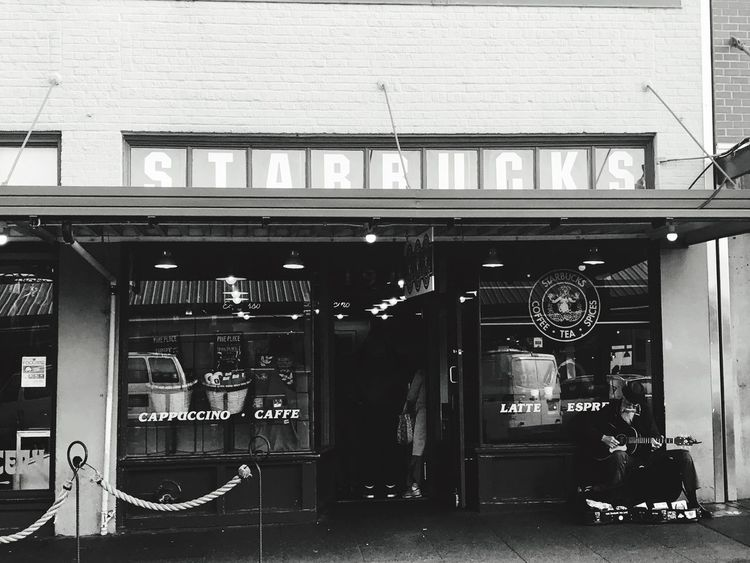 First Starbucks Vintage Style Old Man Old But Awesome Old-fashioned Black & White Black And White Nostalgia Coffee Architecture Communication Text Built Structure No People Western Script Day Building Exterior Sign Connection City