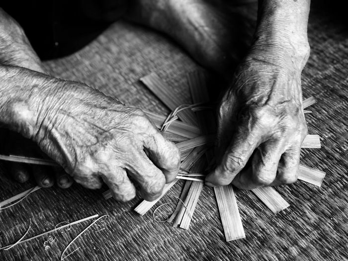 Elderly hand weaving bamboo. Bamboo Weaving Elderly Work Human Hand Hand Human Body Part One Person Real People Art And Craft Indoors  Skill  Men Lifestyles Finger Wood - Material