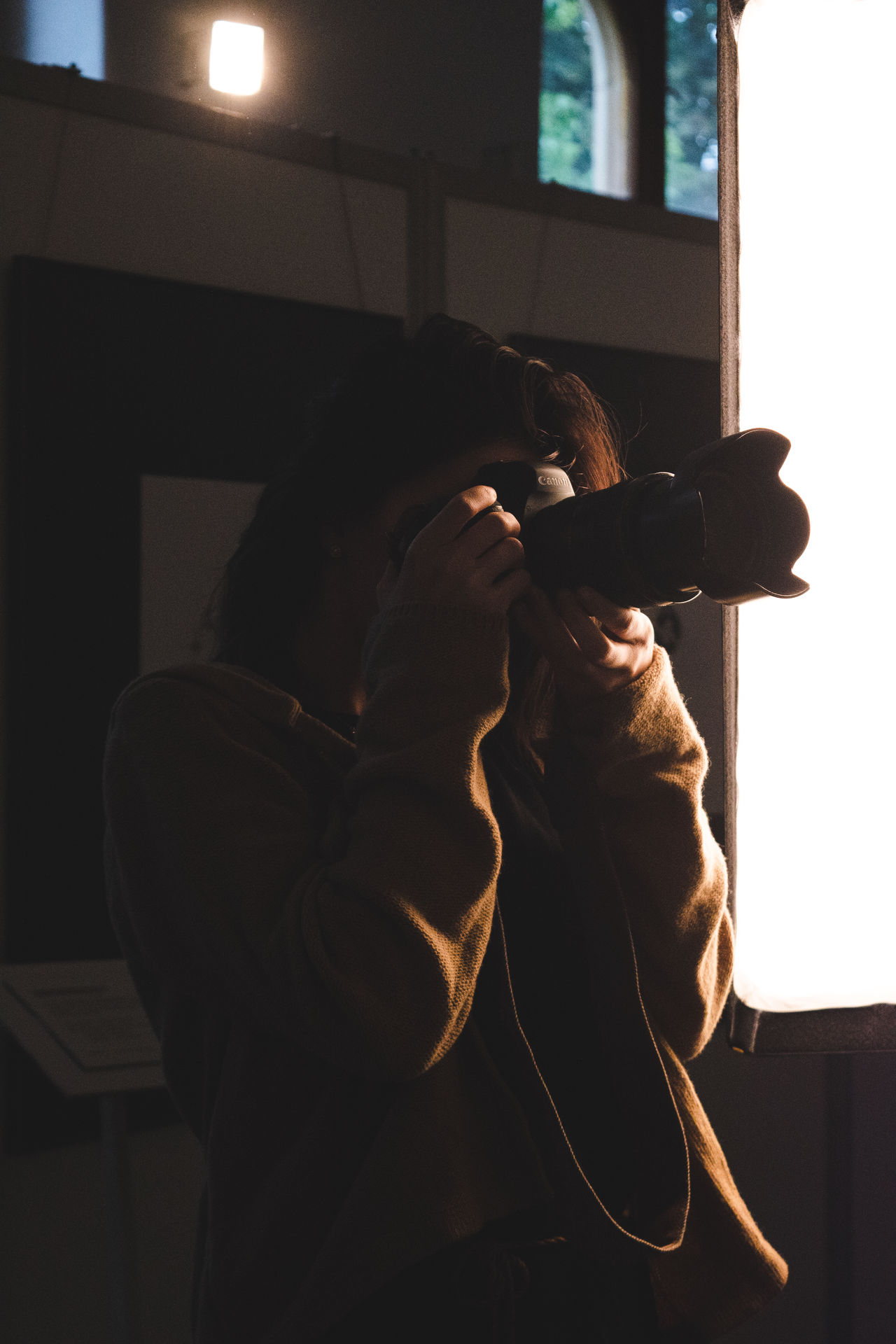 Close-up of young woman photographing through camera