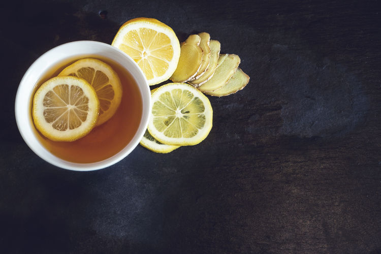 Ingredients Space For Text Citrus Fruit Directly Above Drink Feel Better  Food Food And Drink Freshness Fruit Ginger Healthy Eating High Angle View Home Remedies Lemon No People Refreshment SLICE Soothing Sour Taste Still Life Tabletop Tea Wellbeing Yellow