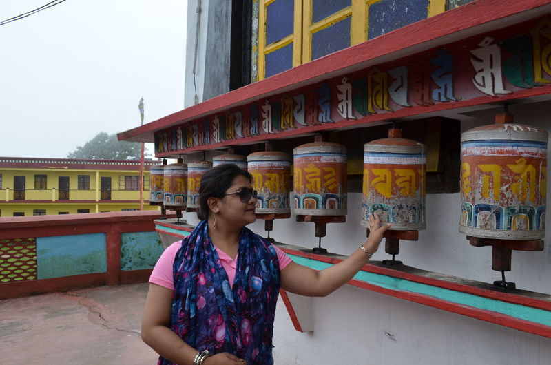 Woman standing at temple