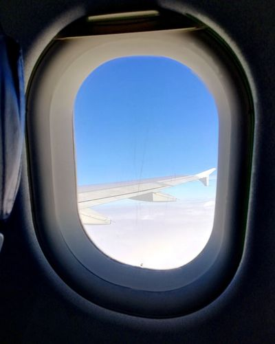 Above 🛫 💚 Window Windowairplane Travel Airplane Air Vehicle Window Flying Blue Commercial Airplane Sky Close-up Landscape