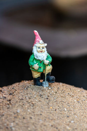 Close-up of small toy on rock