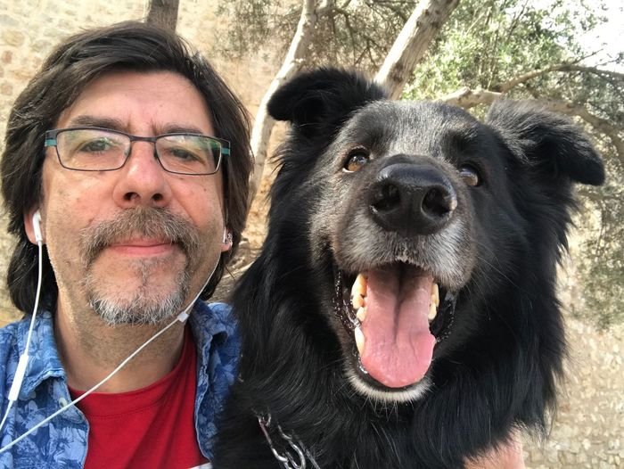 Portrait of man with dog outdoors