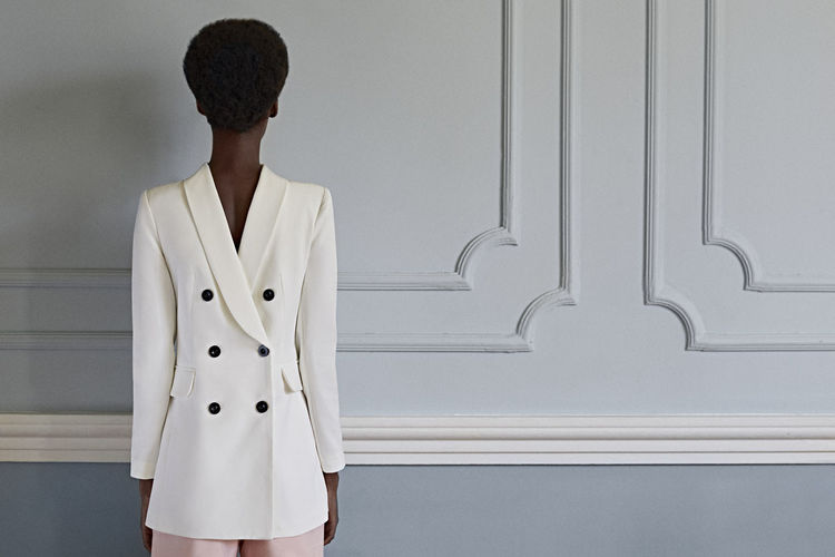 Standing One Person Three Quarter Length Indoors  Real People Clothing Adult Women Young Adult Front View Wall - Building Feature Casual Clothing Leisure Activity Lifestyles Looking Young Women Architecture Hairstyle Contemplation The Portraitist - 2019 EyeEm Awards The Minimalist - 2019 EyeEm Awards The Creative - 2019 EyeEm Awards My Best Photo