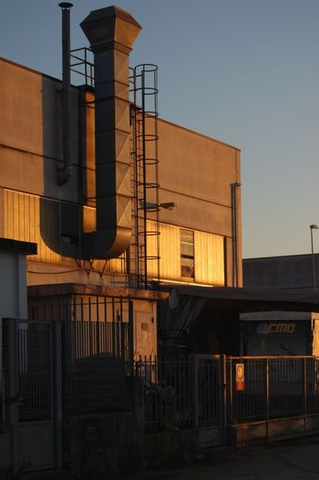 Sunset light Chimney Sunset Lighty Factory Building Lamiera Zona Industriale Tramonto City Politics And Government Prison Business Finance And Industry Orange Color Urban Scene Evening Scenics