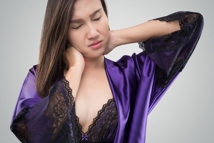 Neck Pain Ache Nightwear Silk Satin Sexywomen Young Women One Person Young Adult Studio Shot Indoors  Women Front View Beauty Purple Beautiful Woman Adult Females Waist Up Fashion Eyes Closed  Lifestyles White Background Hairstyle