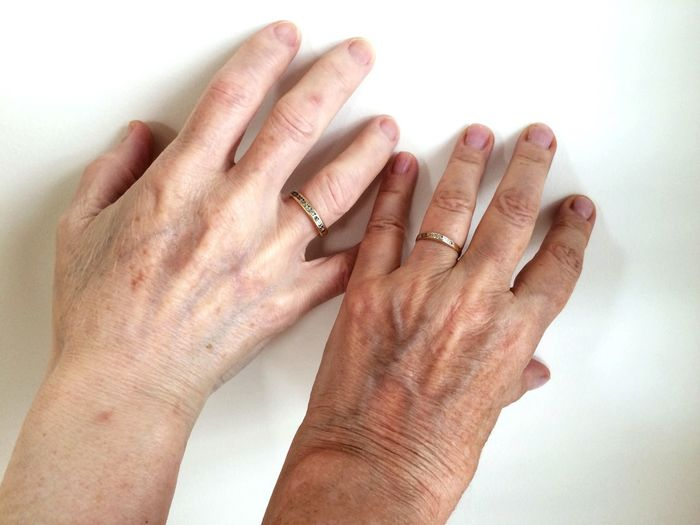 Cropped Senior Couple Hands On Table