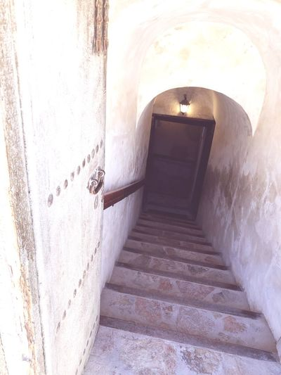 Arabian Architecture Old Architecture Very Old Stairs Entrance Old Fort Nizwa, Oman Nizwa Fort Oman_photography Oman EyeEm Selects Steps Architecture Built Structure Staircase Steps And Staircases Corridor Indoors  Arch Door No People The Way Forward Doorway Day
