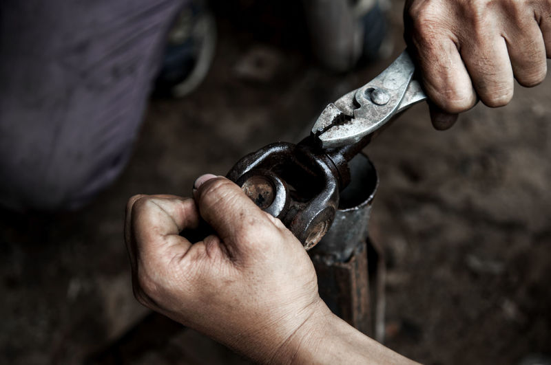 Work Tool Human Hand Hand Human Body Part Holding Working Occupation One Person Workshop Metal Skill  Close-up Indoors  Men Hand Tool Tool Dirt Focus On Foreground Dirty Mechanic