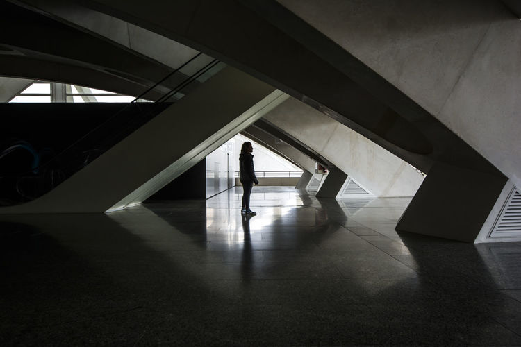Silhouette woman walking in corridor of building