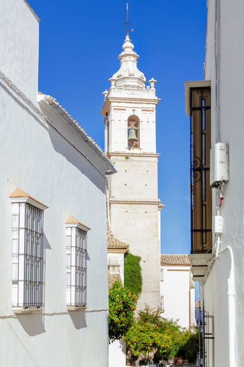 Typical Street in Estepa, province of Seville. Charming white village in Andalusia. Southern Spain. Picturesque travel destination on Spain. Estepa Sevilla Estepa SPAIN Seville Tourism White Villages Sun Sky Europe Cityscape Andalusia Andalusian Architecture City Town Village Andalucía Travel Travel Destinations Blue Architecture Tower Summer Outdoors European  Tourist Mediterranean  Traveler Beautiful Province Street Spanish Traditional Destination Vacations Landmark