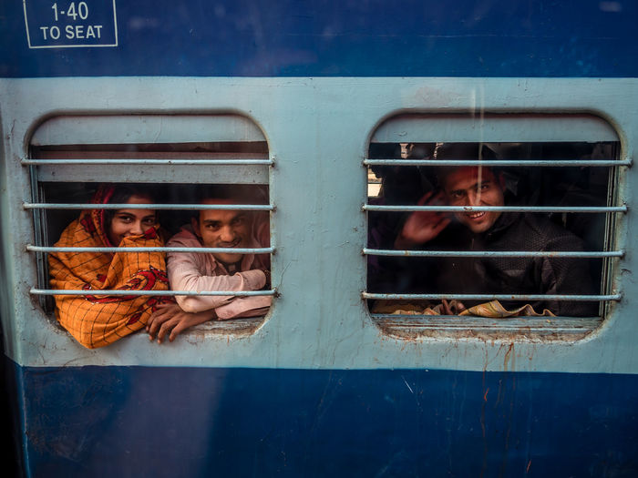 India impressions Indien 2016 India Delhi Portrait Travel Destinations Transportation People Real People Men Group Of People Males  Childhood Child Boys Window Looking At Camera Girls Day Women Headshot Females Mode Of Transportation Metal Outdoors Adolescence  Teenager The Traveler - 2019 EyeEm Awards