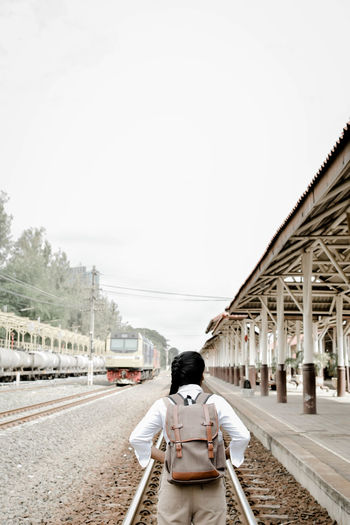 Rear View Of Woman On Railway Tracks