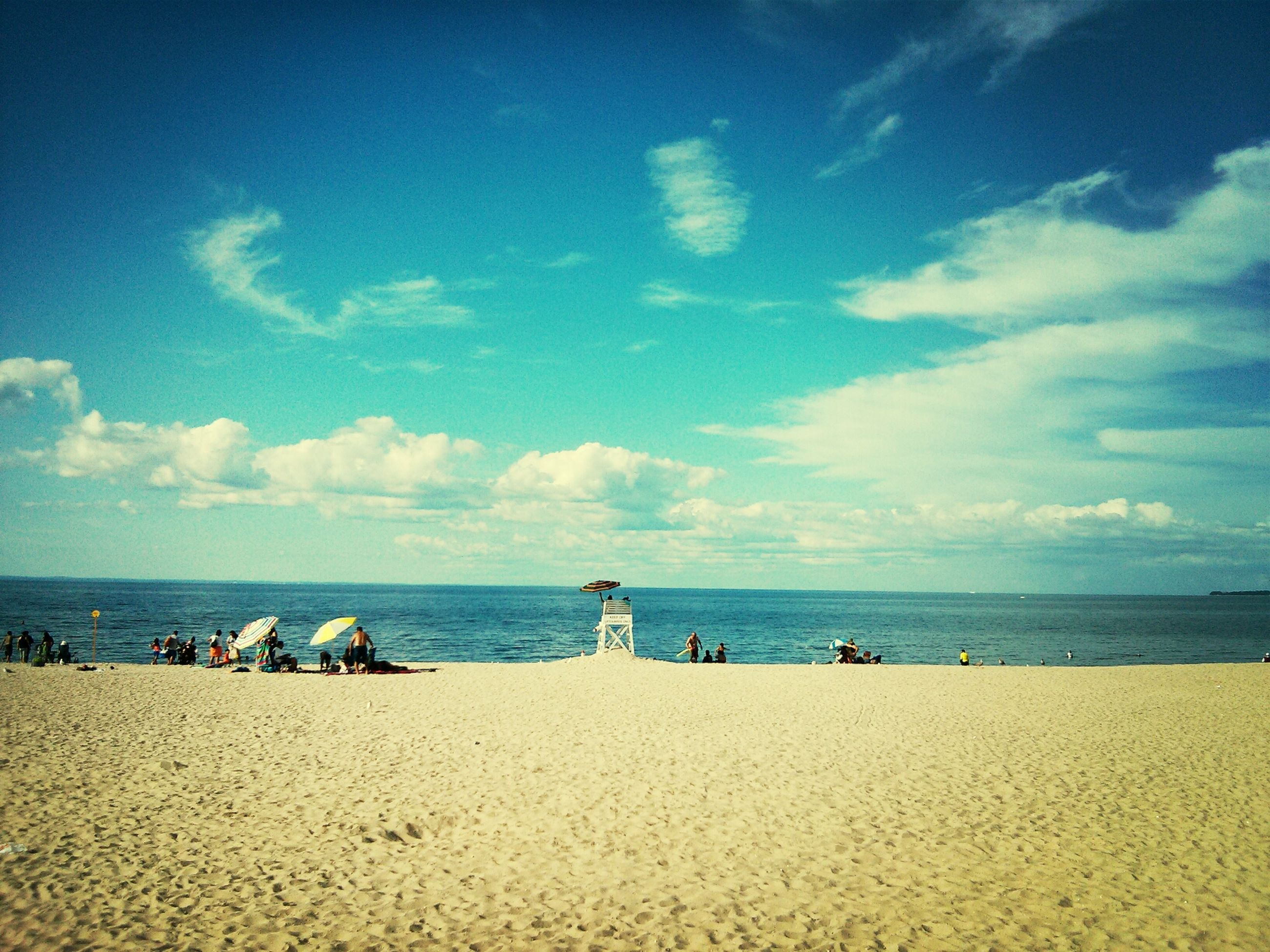 sea, beach, horizon over water, water, sky, sand, tranquil scene, tranquility, shore, scenics, beauty in nature, blue, vacations, nature, idyllic, cloud, relaxation, coastline, incidental people
